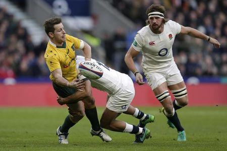 FILE PHOTO: Australia's Bernard Foley is tackled by England's Owen Farrell
