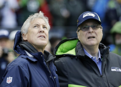 Seahawks owner Paul Allen (R) lets Pete Carroll and the team's front office operate with a high degree of autonomy. (AP)