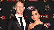 Outpouring of support after AFL couple's devastating announcement