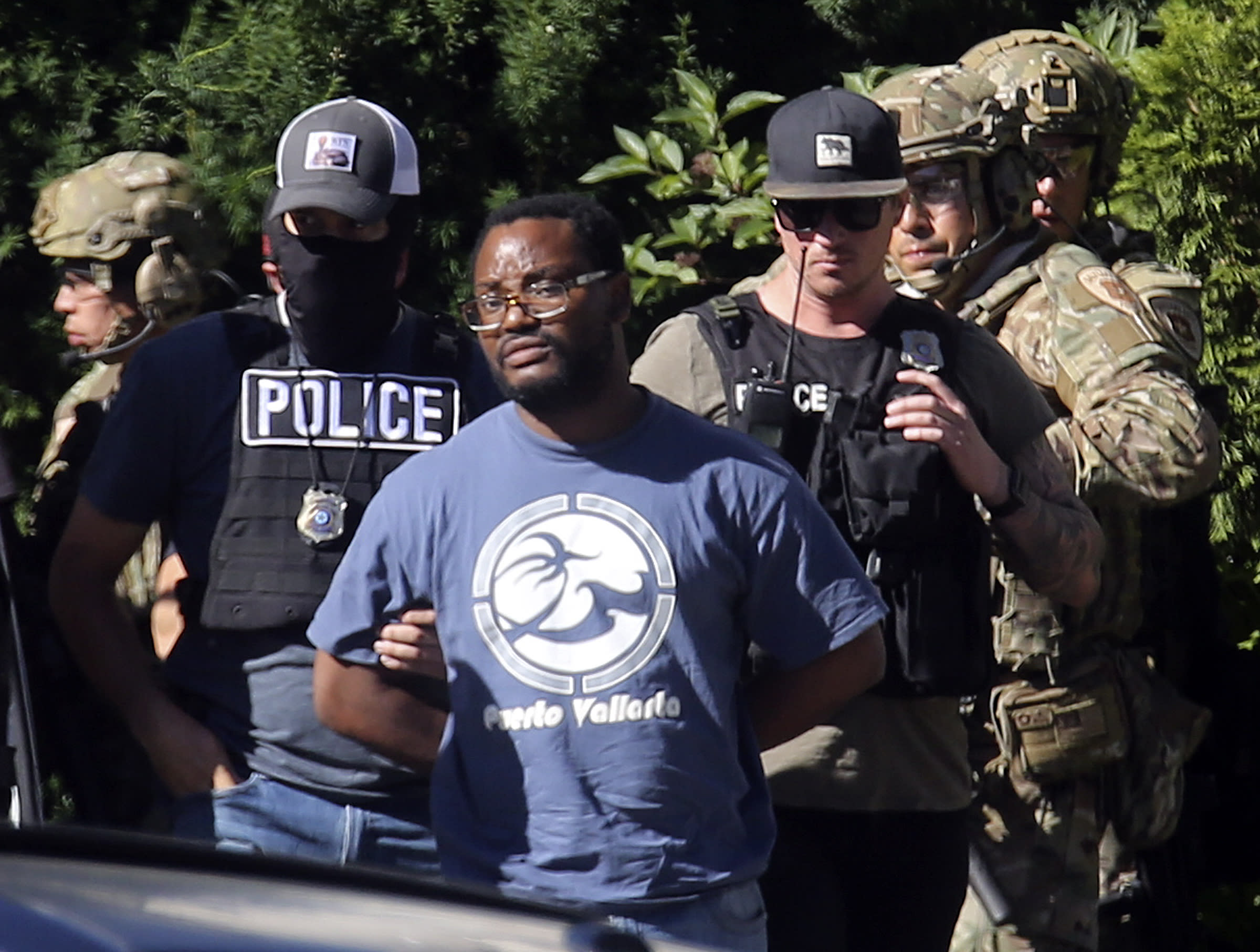 FILE - In this June 28, 2019, file photo, Salt Lake City police take Ayoola A. Ajayi into custody in connection with missing University of Utah student MacKenzie Lueck in Salt Lake City. Ajayi, has been charged with murder, kidnapping and other charges in the death of Lueck. Prosecutors filed the case Wednesday, July 10. District Attorney Sim Gill also said Lueck's cause of death was blunt force trauma to the head, and her body was found with her arms bound behind her. (Kristin Murphy/The Deseret News via AP, File) MANDATORY CREDIT TV OUT