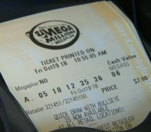 Mega Millions jackpot soars to a record $1 billion