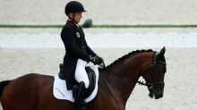 Olympics-Equestrian-German birthday boy Michael Jung takes eventing lead