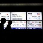 Asian shares on defensive on mounting signs of a global slowdown