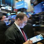 Wall St. rises as Huawei reprieve boosts tech shares
