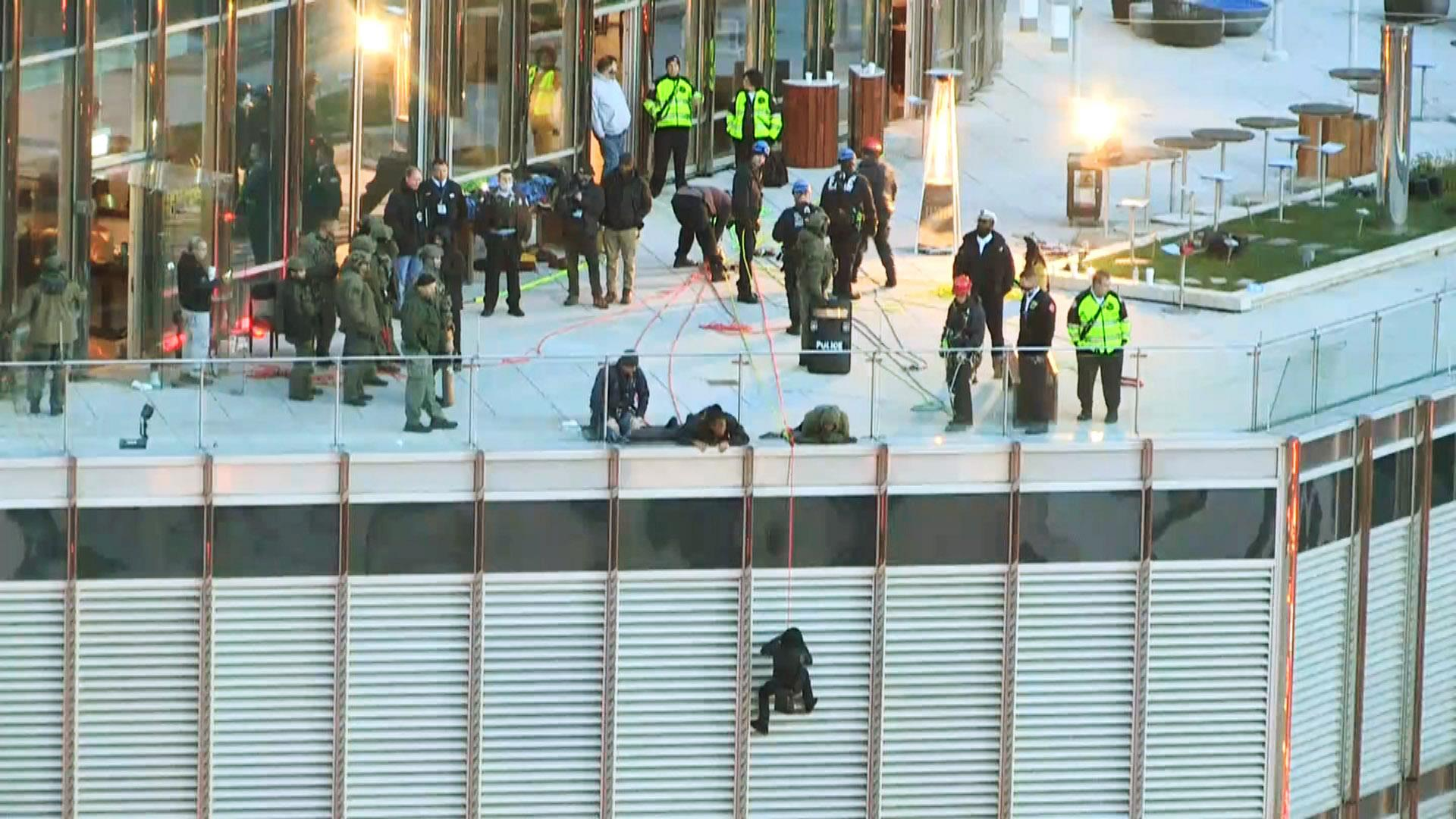 Man hangs off side of Chicago's Trump Tower for 13 hours before being taken into custody