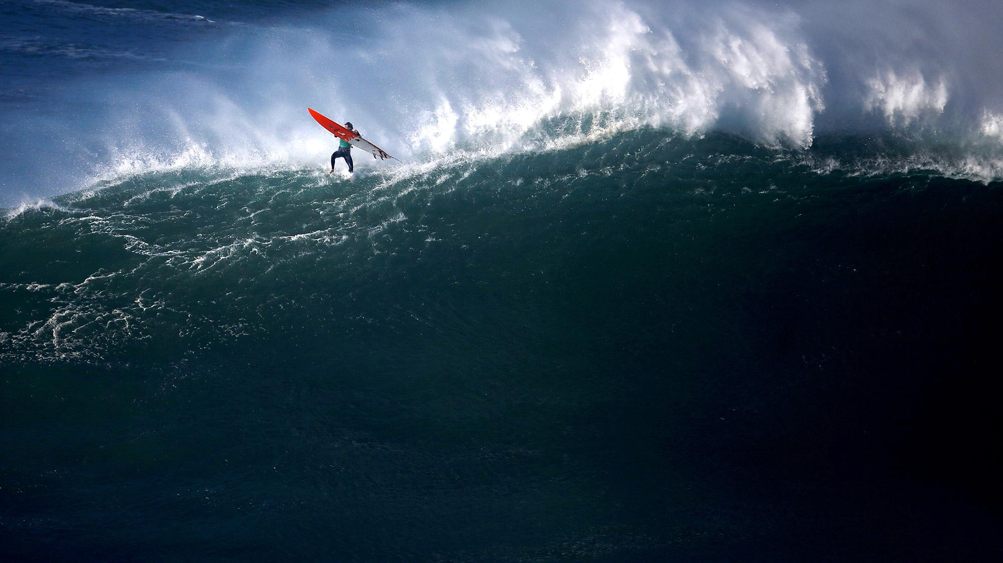 <p>Big-wave surfer Tom Butler of Britain drops in on a large wave during Nazare Challenge championship at Praia do Norte in Nazare, Portugal on Dec. 20 2016. (Photo: Rafael Marchante/Reuters) </p>