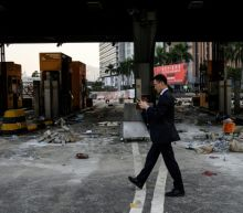 Chinese soldiers leave Hong Kong barracks in rare clean-up cameo