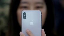 Apple to push software update in China as Qualcomm case threatens sales ban