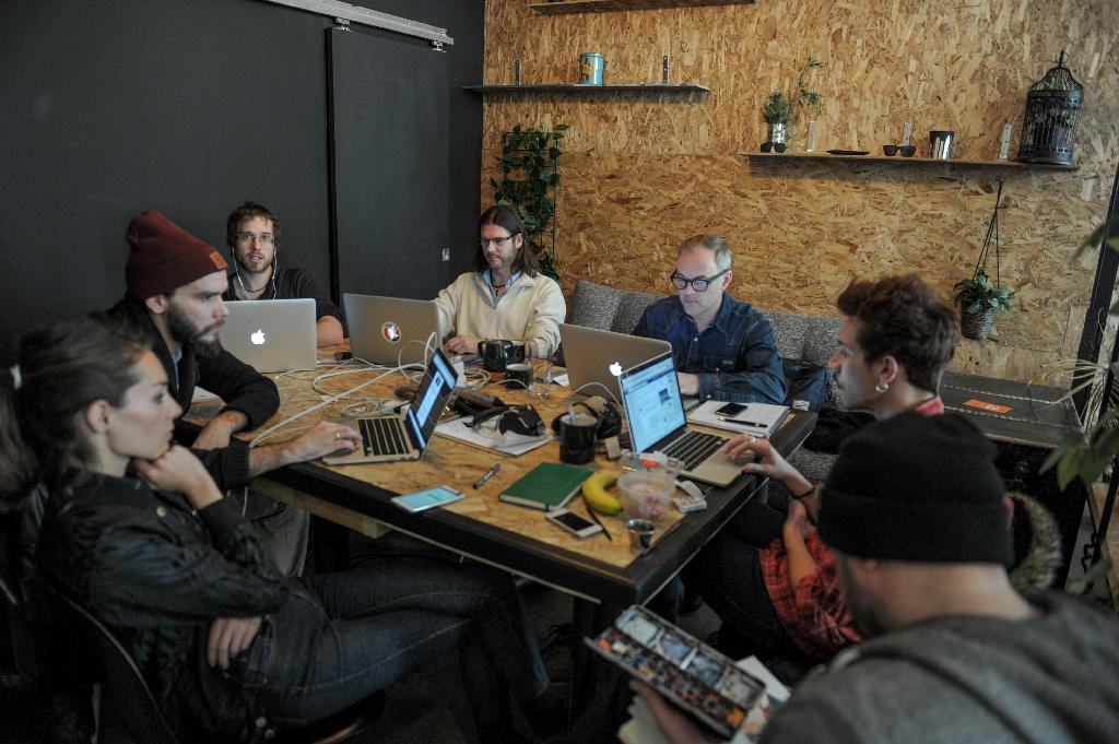 People work around a large table in GAB in downtown Montreal (AFP Photo/Alice Chiche)
