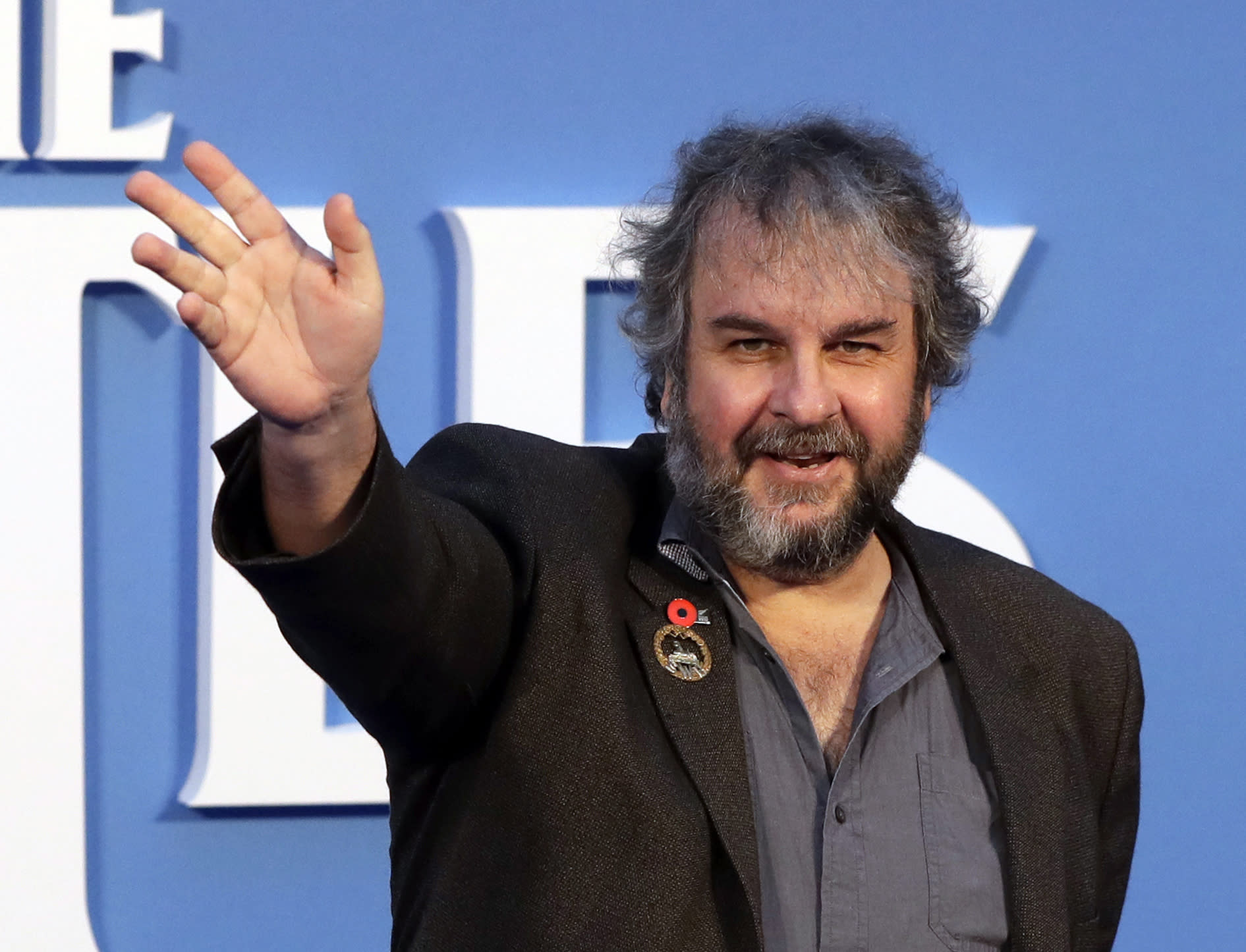 "FILE - In this file photo dated Thursday, Sept. 15, 2016, film director Peter Jackson poses for photographers at the World premiere of the Beatles movie, in London. According to an announcement Tuesday Aug. 21, 2018, Jackson's new film ""They Shall Not Grow Old"" a documentary that transforms grainy footage from World War I into color, will have its world premiere at the London Film Festival in October. (AP Photo/Kirsty Wigglesworth, FILE)"
