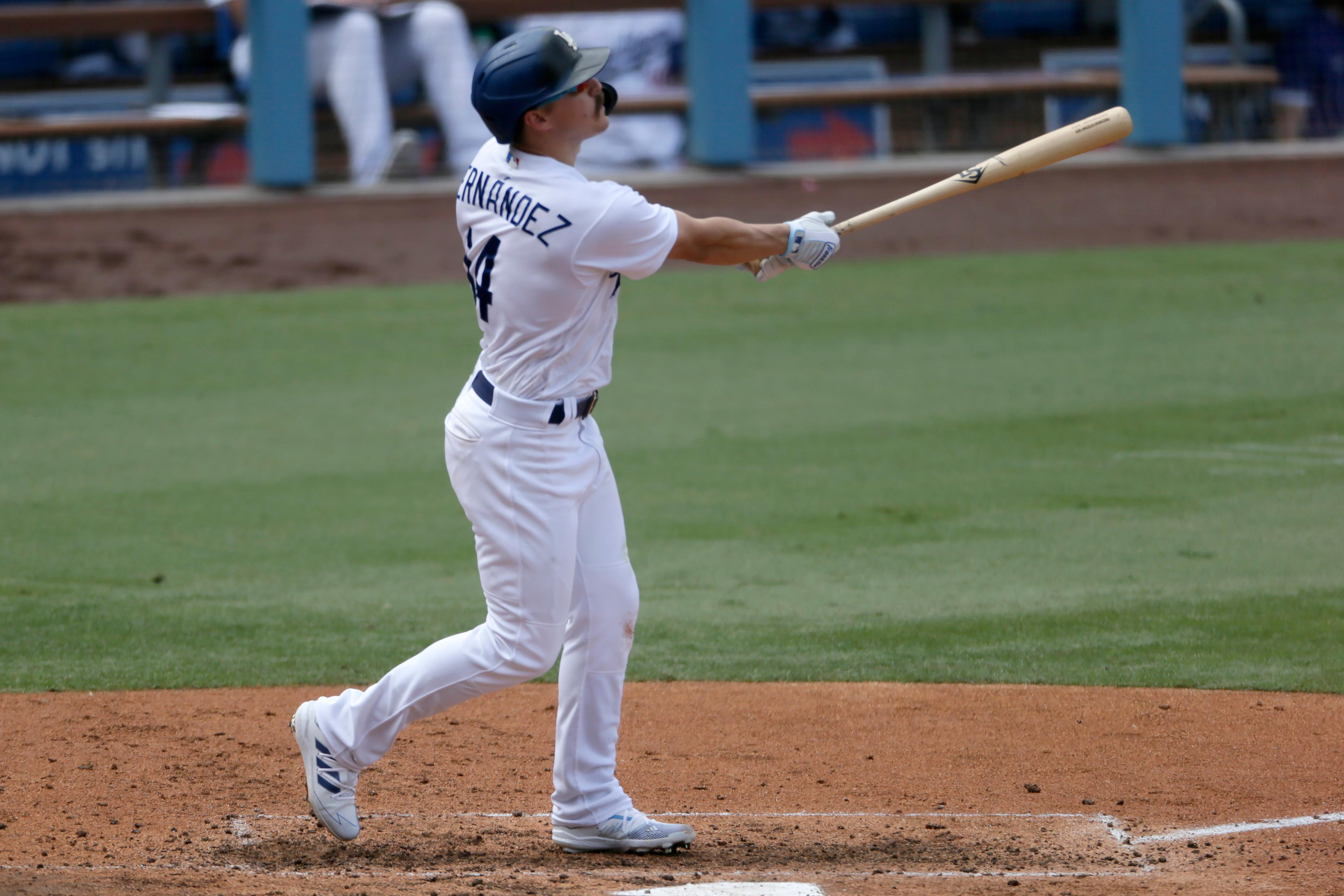 Los Angeles Dodgers' Enrique Hernandez follows through hitting a three-run home run against the Colorado Rockies during the fourth inning of a baseball game in Los Angeles, Sunday, Aug. 23, 2020. (AP Photo/Alex Gallardo)
