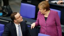 Merkel confirms she would give arch critic job in a new German cabinet