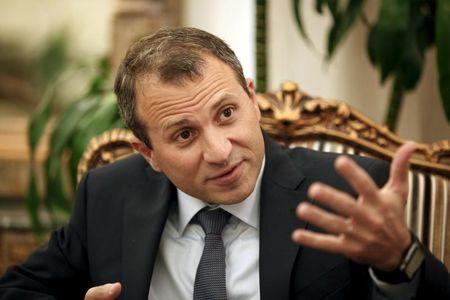 FILE PHOTO: Lebanon's Foreign Minister Gebran Bassil gestures after an interview with Reuters at his office in Beirut