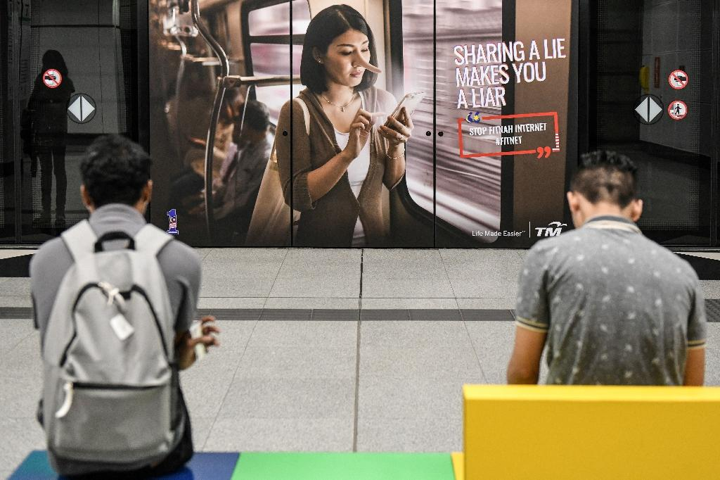 A poster publicising the new law at a Malaysia train station: the first person to run foul of it has been jailed