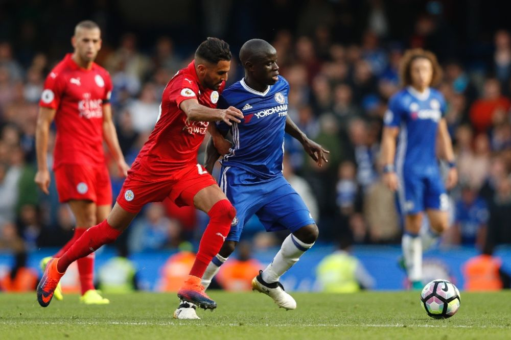 N'Golo Kante (centre right) challenges Riyad Mahrez (centre left) in Chelsea's game against Leicester City at Stamford Bridge