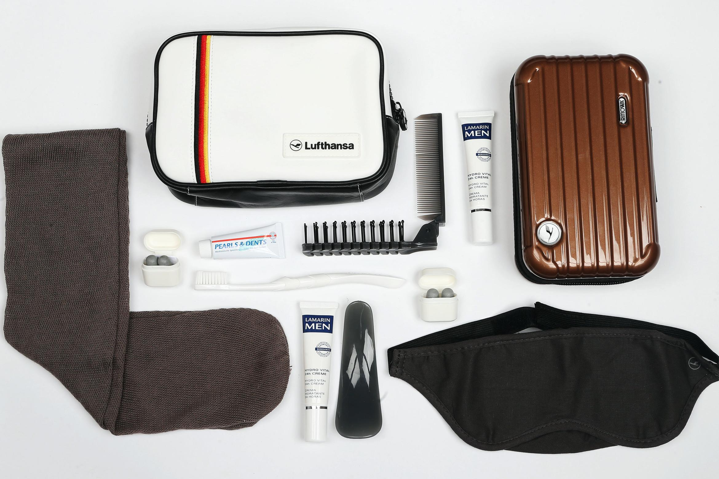 <p><strong>What do you get?</strong> Everything you might possibly need on a flight: Toothbrush, toothpaste, socks, moisturiser, foldable hairbrush/comb, shoe horn, ear plugs, eye mask<br /> <strong>Best bit of the kit?</strong> The bag with the German colours. It reminds us of the heady days of summer 2014 when Germany won the World Cup.</p>