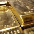 Gold edges up on dollar weakness, but strength in the stock market on vaccine hopes caps gain