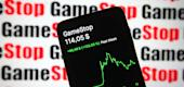 In this photo illustration the GameStop stock price and a chart are seen on a smartphone screen. (Getty)