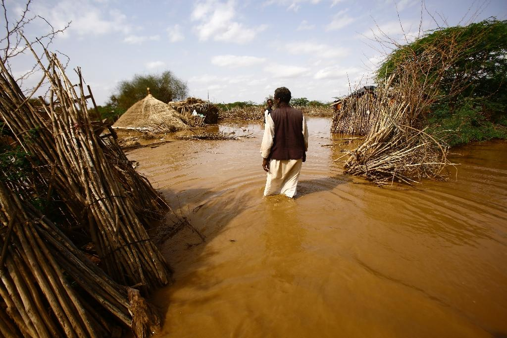 A Sudanese man returns to his destroyed house and looks for his food stock and other belongings in the village of Makli, that was flooded after the river Gash burst its banks on August 14, 2016, in the impoverished eastern state of Kasala (AFP Photo/Ashraf Shazly)