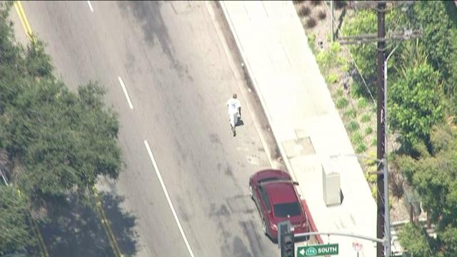Freeway Pursuit Leads to Search for Armed Suspect in North Hollywood