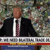 People are losing it over the speech Donald Trump gave in front of a wall of garbage