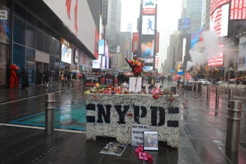 The impromptu memorial in Times Square