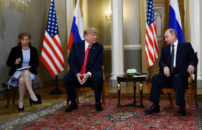 Russian President Vladimir Putin and US President Donald Trump at a July 2018 summit in Helsinki where Trump controversially acknowledged Putin's denials of election meddling (AFP Photo/Brendan Smialowski)