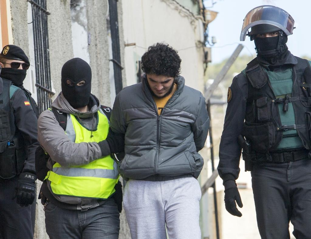 One of four people suspected of using Internet platforms to recruit young women to join the Islamic State group is arrested in the Spanish enclave Melilla on February 25, 2015 (AFP Photo/Angela Rios)