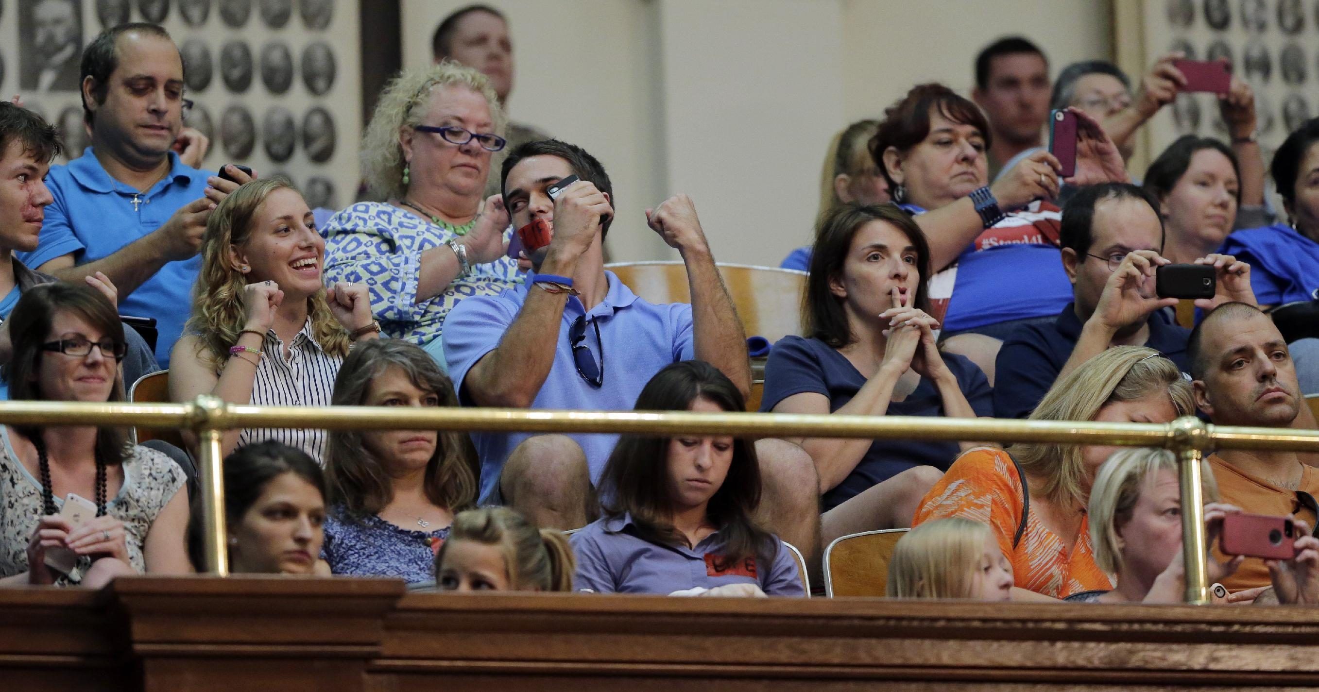 ADDS THAT BILL IS PROVISIONALLY APPROVED, WITH FINAL VOTE SCHEDULED FOR WEDNESDAY - Supporters of HB 2, an abortion bill, react in the gallery of the Texas House after the bill was provisionally approved, Tuesday, July 9, 2013, in Austin, Texas. A final, formal vote is scheduled for Wednesday. The bill would require doctors to have admitting privileges at nearby hospitals, only allow abortions in surgical centers, dictate when abortion pills are taken and ban abortions after 20 weeks. (AP Photo/Eric Gay)