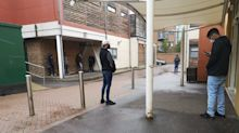 'We were told she'd miscarried. Then I was told to go outside.' Poignant photo shows men waiting by maternity ward due to coronavirus restrictions