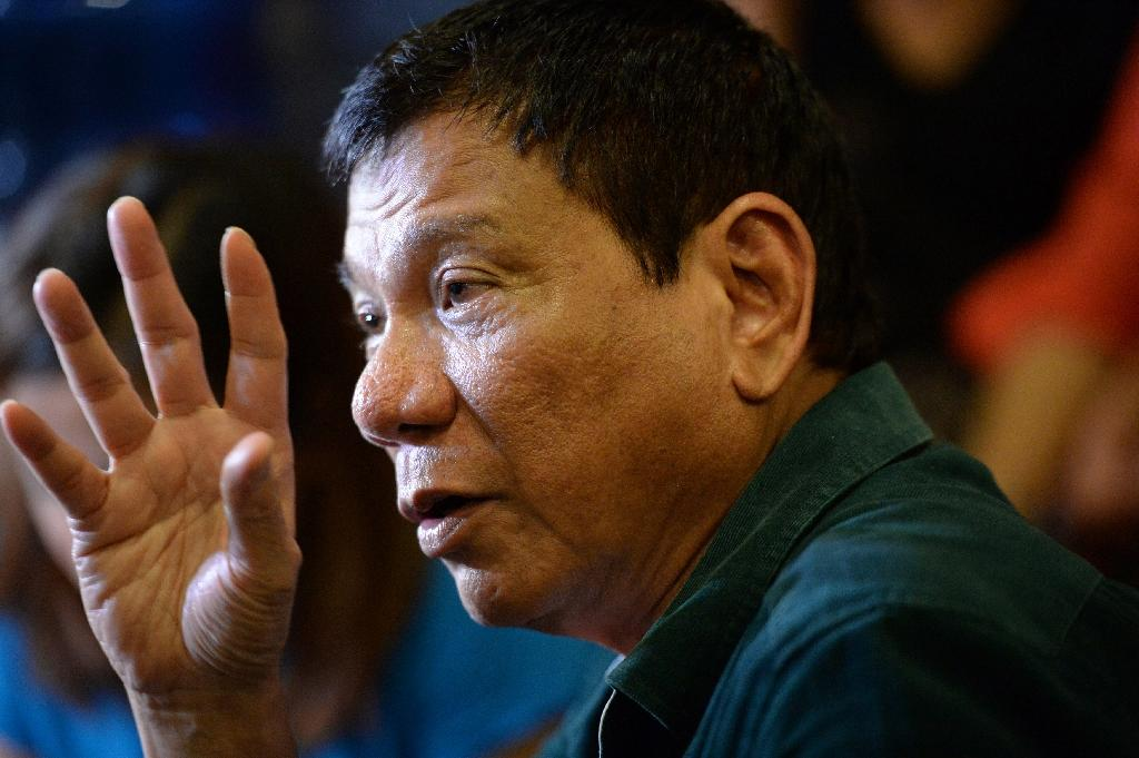 Philippines' President-elect Rodrigo Duterte speaks to the media at a restaurant in Davao City on May 15, 2016 (AFP Photo/Ted Aljibe)