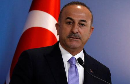 Turkish Foreign Minister Mevlut Cavusoglu attends a news conference in Ankara