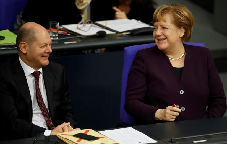 Merkel's partners choose left-leaning leadership