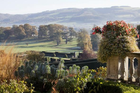 """<p> </p> <p class=""""p1""""> Rising dramatically above the terraced garden and estate, this medieval fortress provides an outstanding autumnal setting. The warm, welcoming colours of the castle appear to echo the rich hues of seasonal foliage, as the red walls match the red vines and the leaves in the surrounding woodlands.</p>"""