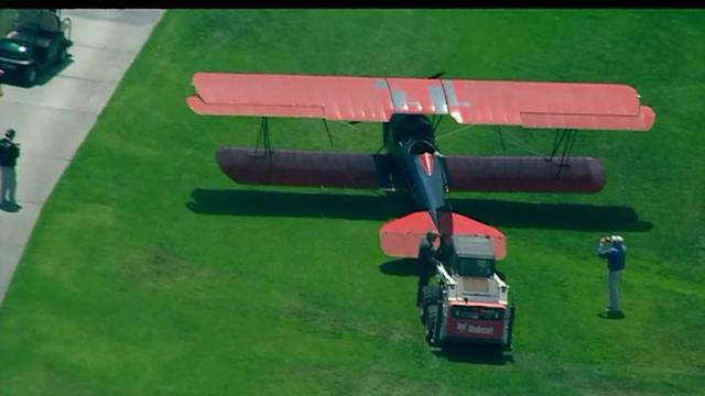 Biplane Makes Emergency Landing On Golf Course