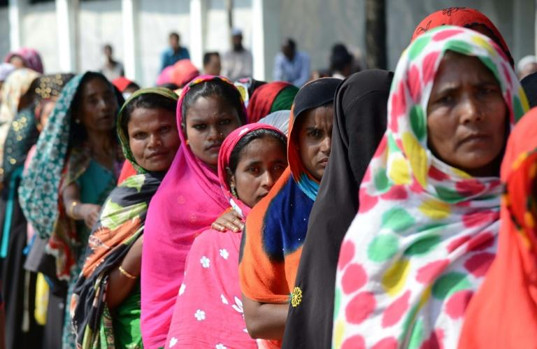 Muslim women voters queue to cast their votes at a polling station during India's general election in Samuguri, some 155 kilometers (about 100 miles) from the Assam capital Guwahati