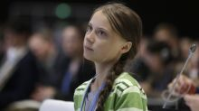 Greta Thunberg stuck on floor of crowded German train after climate summit