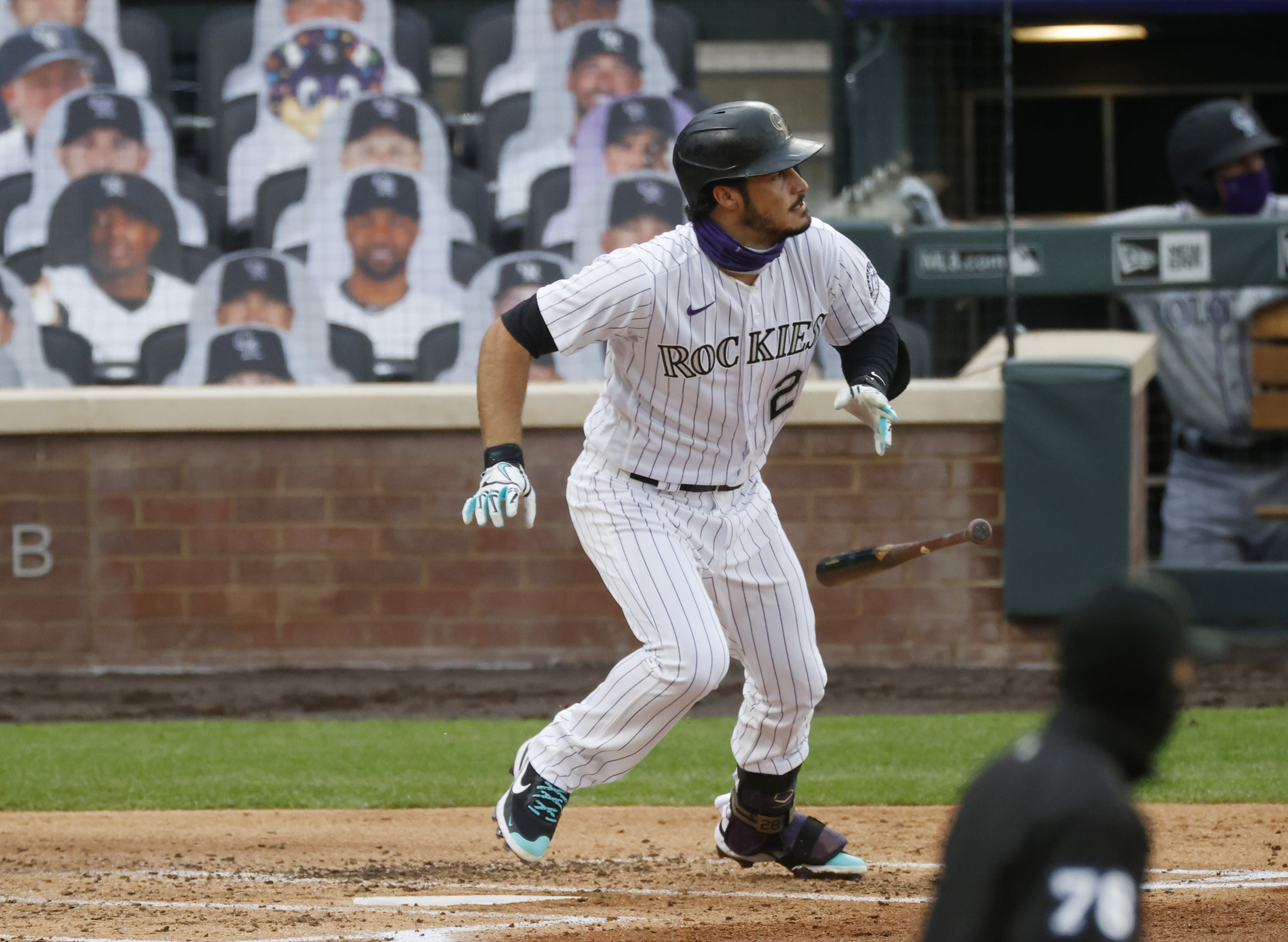 Colorado Rockies' Nolan Arenado breaks from the batter's box as he grounds out to San Diego Padres third baseman Manny Machado to end the bottom of the second inning of a baseball game Saturday, Aug. 1, 2020, in Denver. (AP Photo/David Zalubowski)