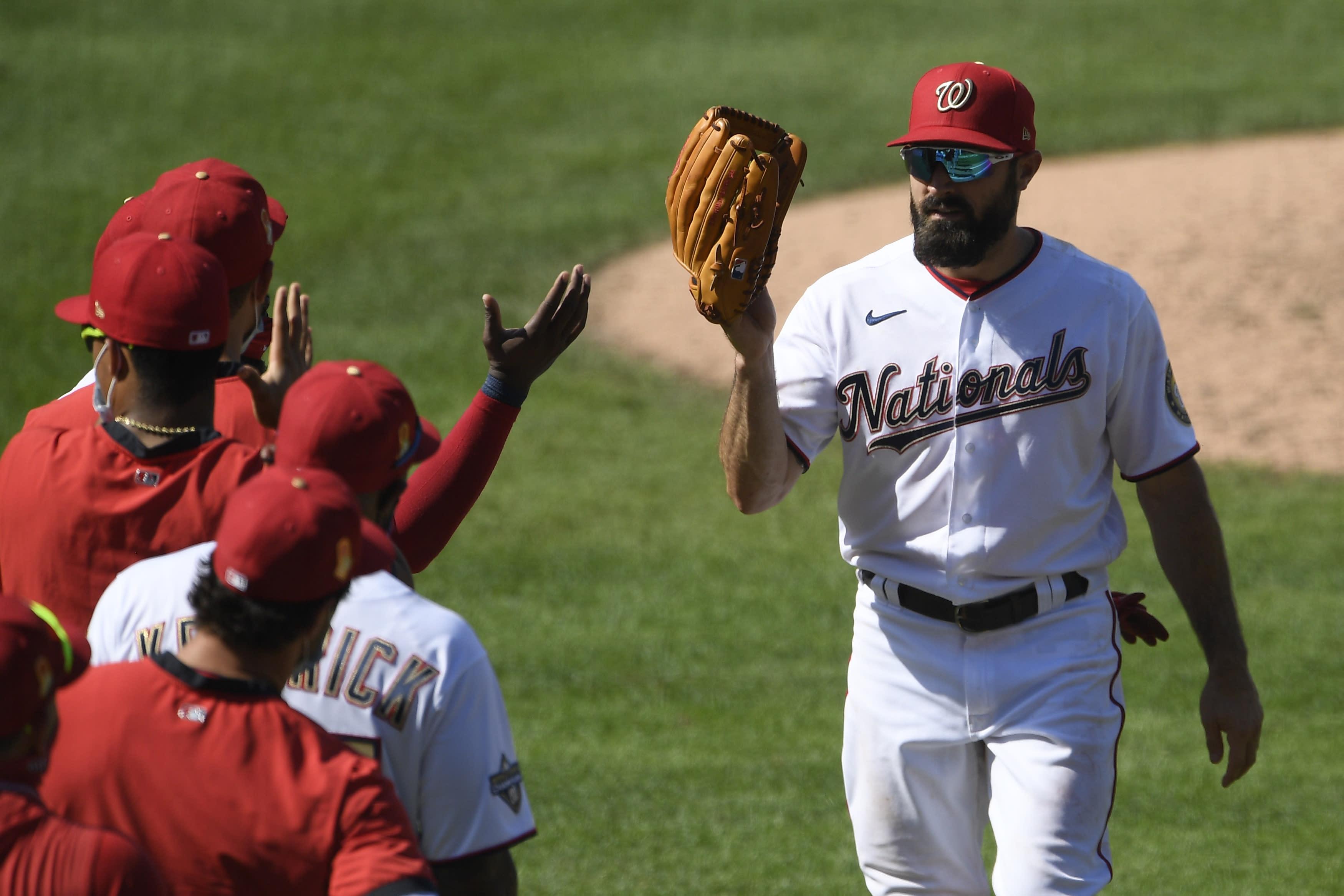 Washington Nationals' Adam Eaton celebrates after a baseball game against the Miami Marlins, Sunday, Aug. 23, 2020, in Washington. (AP Photo/Nick Wass)