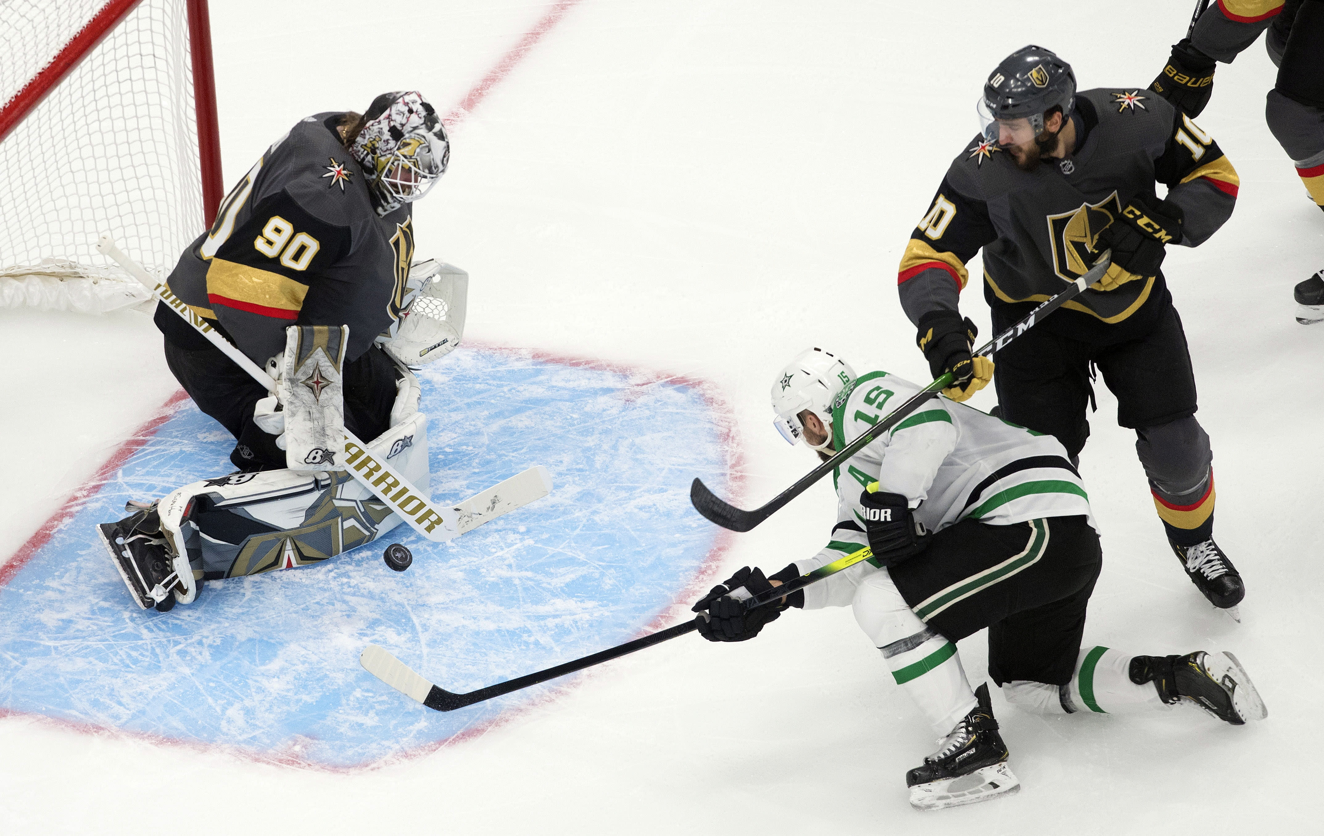 Dallas Stars' Blake Comeau (15) is stopped by Vegas Golden Knights goalie Robin Lehner (90) as Golden Knights' Nicolas Roy (10) defends during first-period NHL Western Conference final playoff game action in Edmonton, Alberta, Monday, Sept. 14, 2020. (Jason Franson/The Canadian Press via AP)