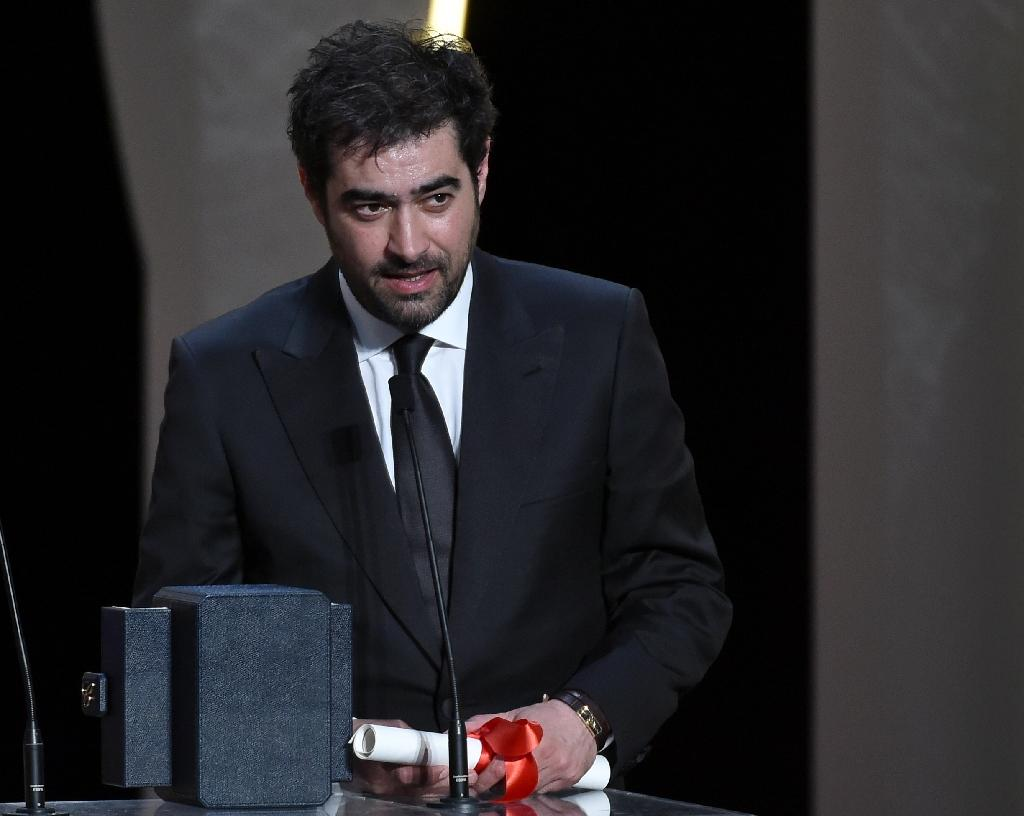 Iranian actor Shahab Hosseini talks on stage after being awarded with the Best Actor prize during the closing ceremony of the 69th Cannes Film Festival in Cannes, southern France, on May 22, 2016