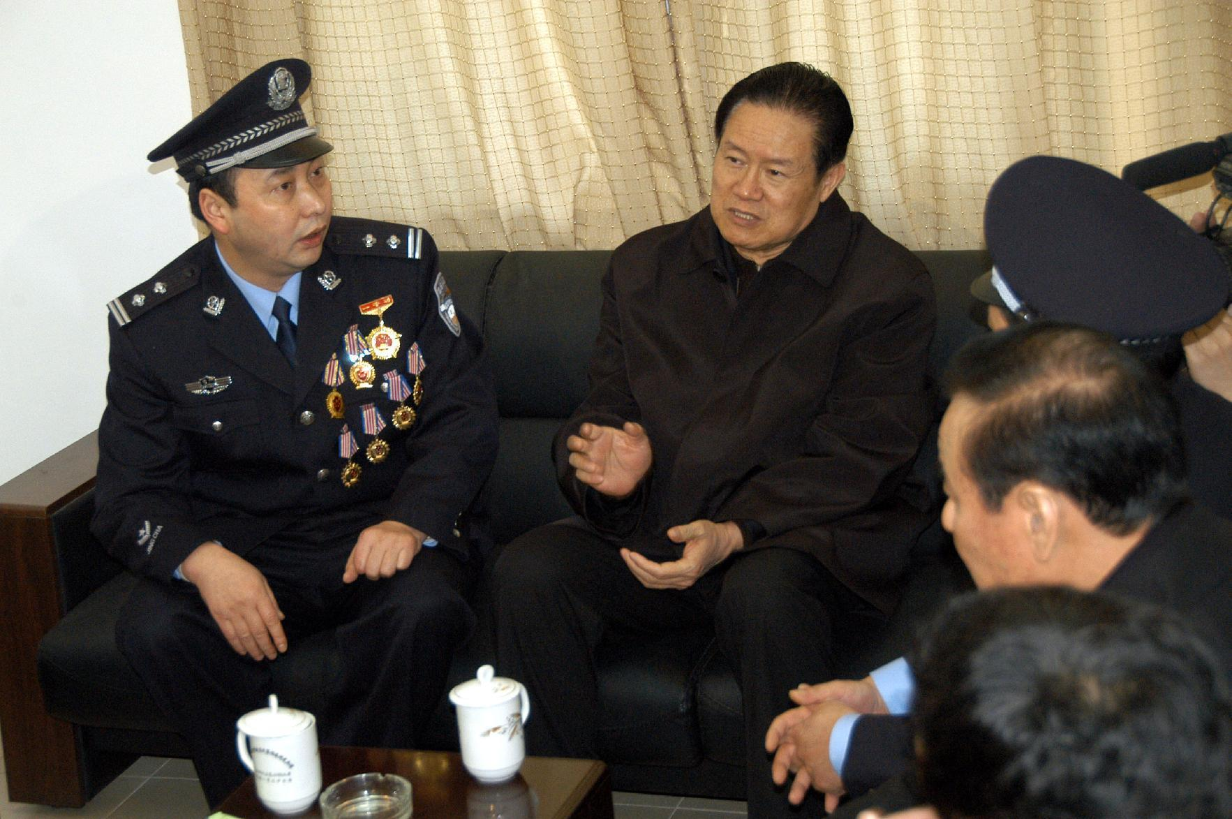 This photo taken on February 1, 2006 shows China's former security chief Zhou Yongkang (centre) visiting police officers in Guiyang, southwest Guizhou province (AFP Photo/)