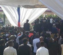 Shots, tear gas, burning tires mar Moïse funeral in Haiti. U.S., U.N. delegations leave