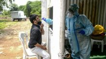 India virus deaths pass 100,000