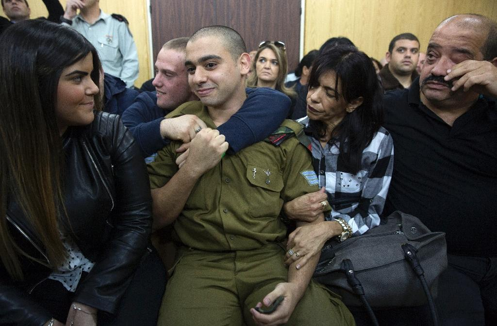 Israeli soldier Elor Azaria (C), was convicted of manslaughter after a trial in a military court which deeply divided the country (AFP Photo/Heidi Levine)