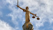 Judge says his sacking for posting abusive comments was unfair