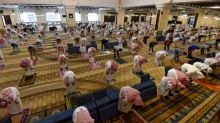Masks and no ablution: Saudis flock to reopened mosques