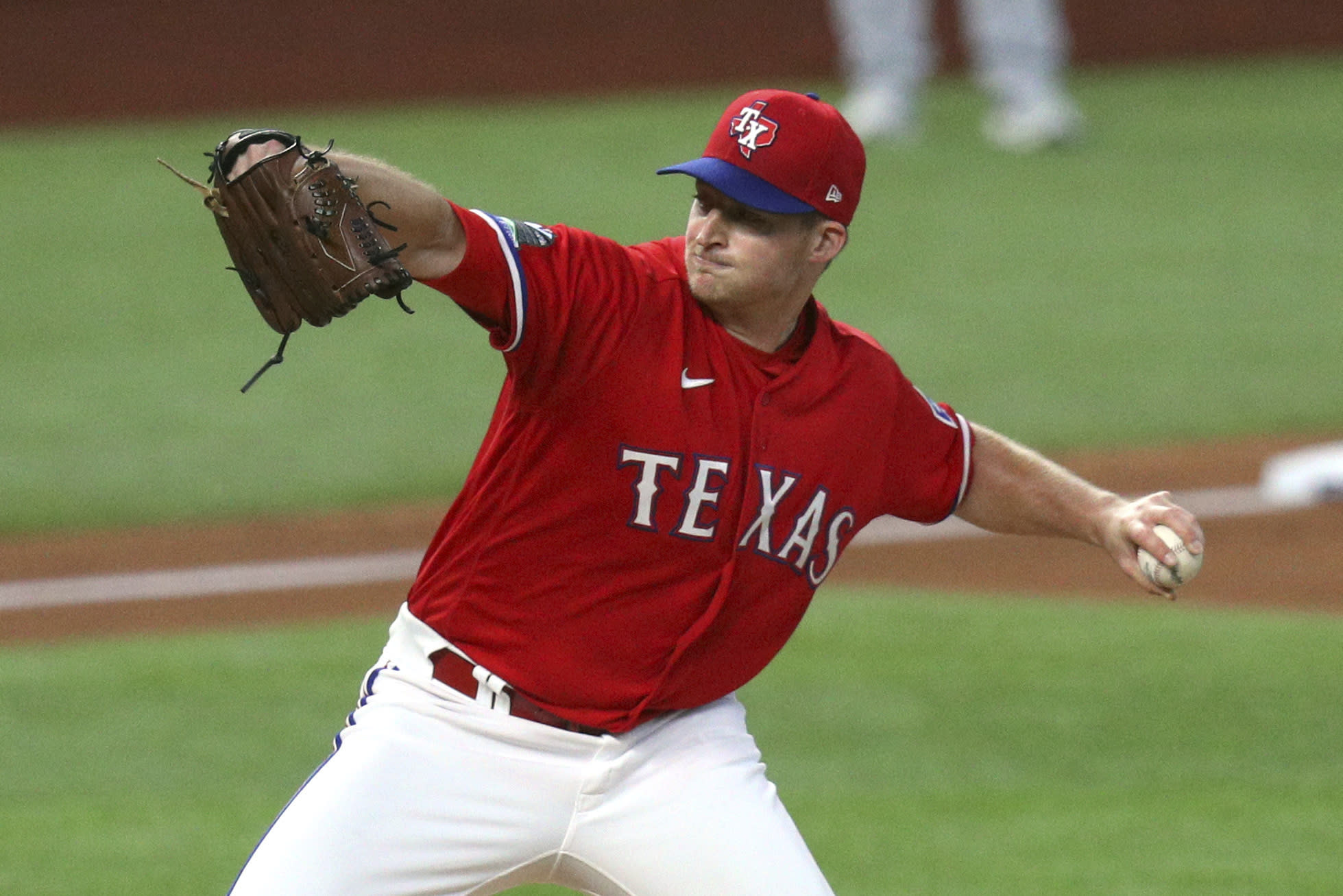 Texas Rangers relief pitcher Wes Benjamin (75) works the third inning against the Oakland Athletics in a baseball game Saturday, Sept. 12, 2020 in Arlington, Texas. (AP Photo/Richard W. Rodriguez)