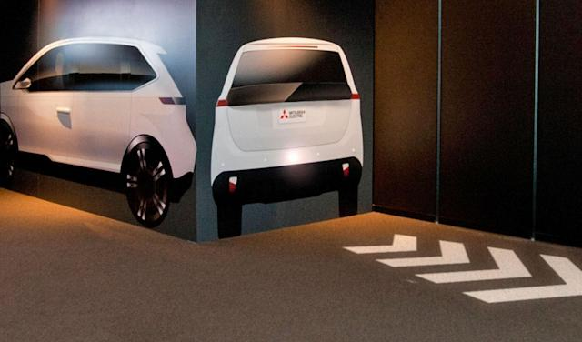 Mitsubishi's turn signals of the future are projected on the road