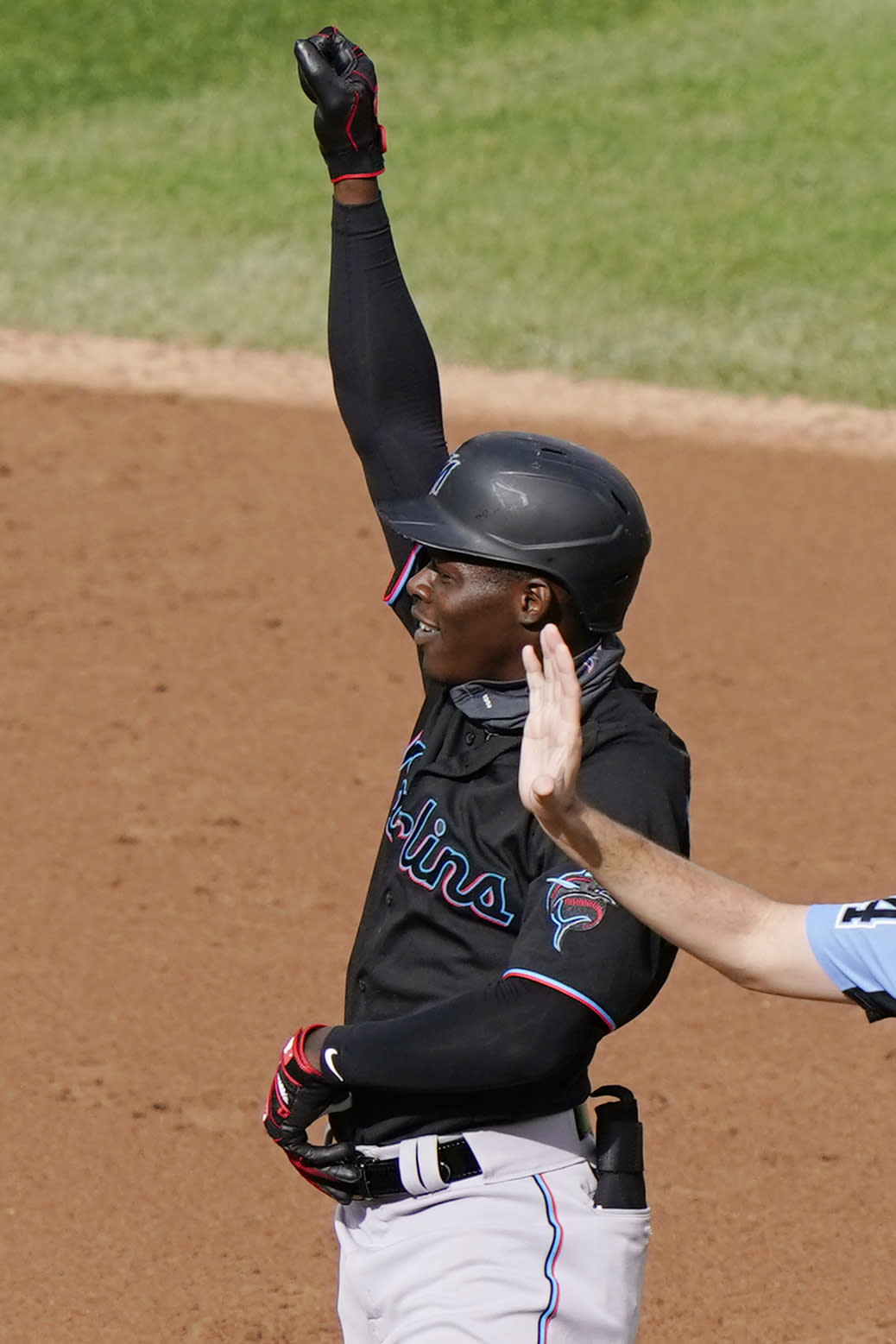 Miami Marlins Jazz Chisholm gestures to the Marlins dugout after hitting a two-run double during the second inning of a baseball game against the New York Yankees, Sunday, Sept. 27, 2020, at Yankee Stadium in New York. (AP Photo/Kathy Willens)